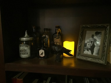 Potion bottles decorating the bookshelf