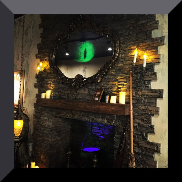 The fireplace and all-seeing mirror at The Cauldron