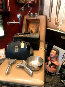 A patient's bed and doctor's tool at Bearded Lady Vintage & Oddities