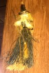 A witch doll made out of straw