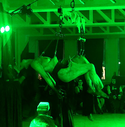 Coven of Ashes performers hanging on body suspensions provided by Embrace Chaos