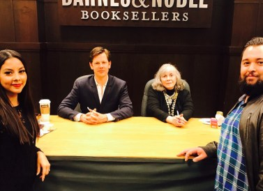 My husband and me taking a photo with Anne and Christopher Rice