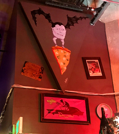 Horror-inspired wall art at The 4th Horseman