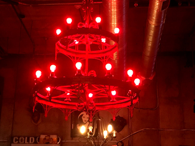 The red chandelier that hangs above the dining area