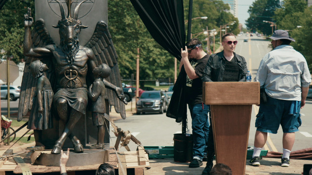 Lucien Greaves at a rally in front of the State Capitol building in Little Rock, Arkansas (Photo courtesy of Magnolia Pictures)