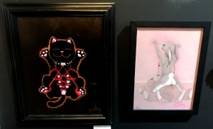"From left to right: ""The Very Lucky cat"" and ""La Petit Morte"" by Bunny Raunch"