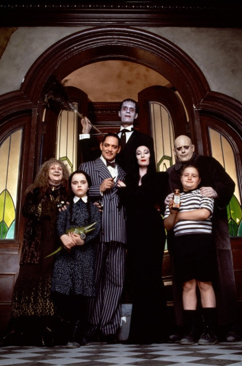 From left to right: Judith Malina as Grandma;    Christina Ricci as Wednesday Addams; Raúl Juliá as Gomez Addams; Carel Struycken as Lurch; Anjelica Huston as Morticia Addams; Christopher Lloyd as Uncle Fester; Jimmy Workman as Pugsley Addams (© Paramount Pictures)