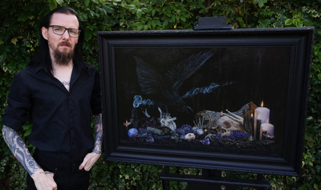 "Martin Darkside photographed with his ""Witchcraft"" still life oil painting"